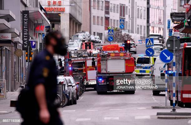 Emergency servies work at the scene where a truck crashed into the Ahlens department store at Drottninggatan in central Stockholm April 7 2017 PHOTO...