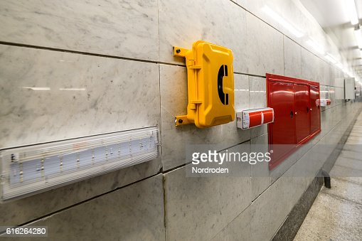 Emergency signs and emergency telephone at the railway station. : Stock Photo