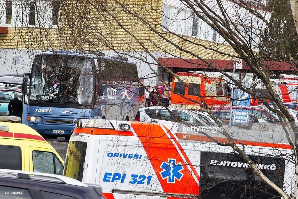 Emergency vehicles are seen on March 30, 2012 at the school in Orivesi, some 45kms northeast of Tampere, where a gunman opened fire at the crowded school and inside an office building before being arrested, officials said, in what appeared to be a revenge attack on an ex-girlfriend. No-one was injured in the school attack but police said one person was slightly wounded in the office building. AFP PHOTO / LEHTIKUVA /Mika Kanerva