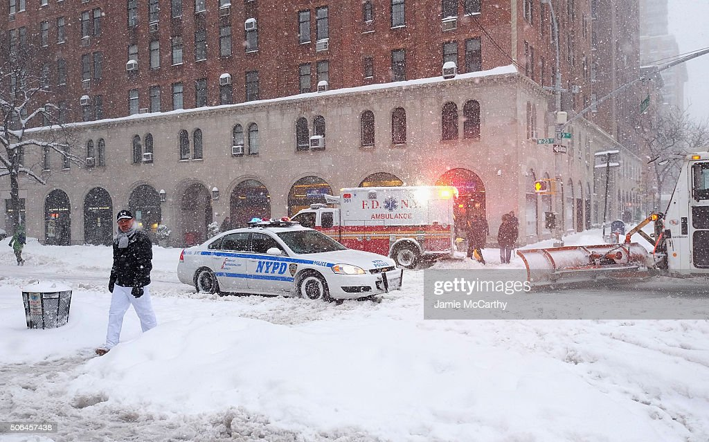 Emergency Vehicles in the empty streets in Chelsea during blizzard conditions on January 23 2016 in New York United States Over a foot of snow has...