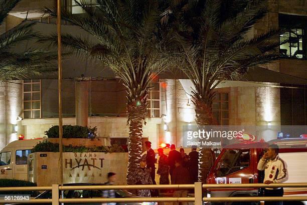 Emergency vehicles sit in front of the Hyatt hotel after an explosion November 9 2005 in Amman Jordan Explosions rocked three hotels the Hyatt...
