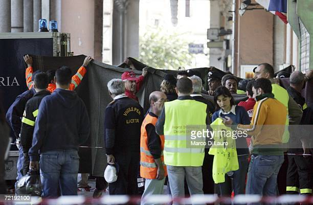 Emergency workers and Police hold up blankets as people are carried out of a metro station after two trains collided during rush hour October 17 2006...