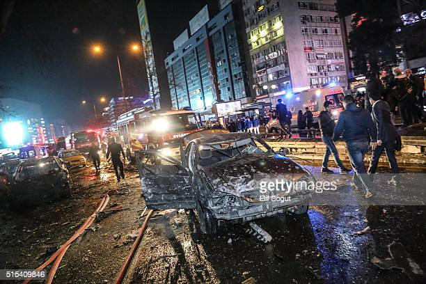 Emergency workers are seen at the explosion site on March 13 2016 in Ankara Turkey At least 27 people were killed and 75 wounded in an explosion in...