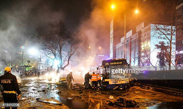 Emergency workers are seen helping victims at the explosion site on March 13 2016 in Ankara Turkey At least 27 people were killed and 75 wounded in...