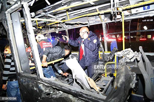 Emergency workers are seen on a bus at the explosion site on March 13 2016 in Ankara Turkey At least 27 people were killed and 75 wounded in an...