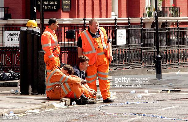 Emergency workers attend the scence near Edgware Road station following a series of explosions which ripped through London's underground tube network...