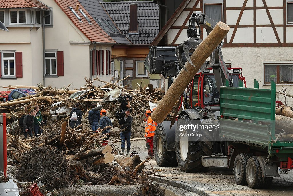 Emergency workers clear smashed trees, cars and other debris in the village center following a furious flash flood the night before on May 30, 2016 in Braunsbach, Germany. The flood tore through Braunsbach, crushing cars, ripping corners of houses and flooding homes during a storm that hit southwestern Germany. Miraculously no one in Braunsbach was killed, though three people died as a result of the storm in other parts of the country.