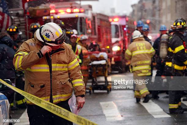 Emergency workers converge at the scene of a collapsed crane in a roadway in lower Manhattan on February 5 2016 in New York City The accident killed...