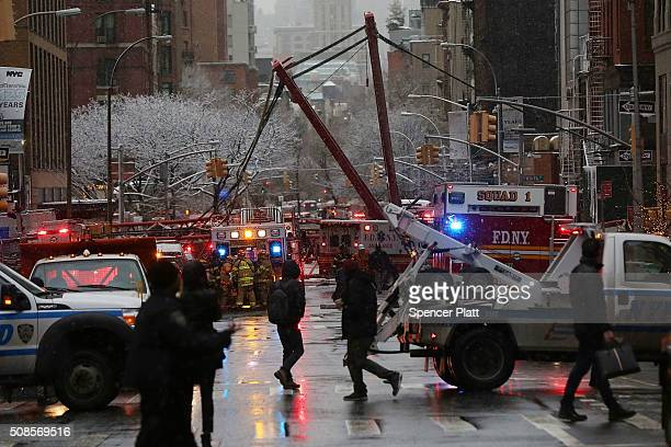 Emergency workers converge at the scene of a collapsed crane in a roadway in lower Manhattan Friday morning oon February 5 2016 in New York City The...
