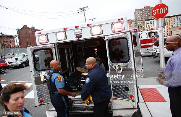 TOPSHOT Emergency workers help an injured person at New Jersey Transit's rail station in Hoboken New Jersey September 29 2016 A commuter train...