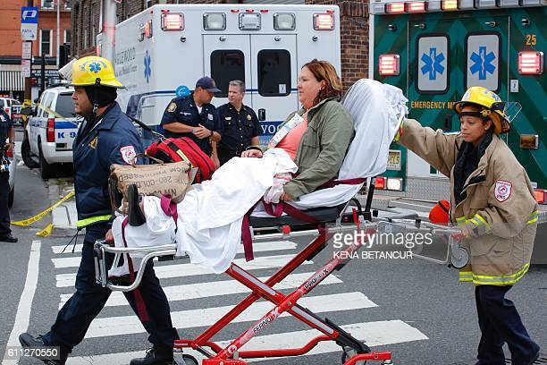 Emergency workers help an injured person at New Jersey Transit's rail station in Hoboken New Jersey September 29 2016 A commuter train crashed into a...