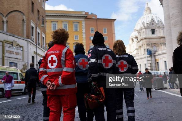 Emergency workers pause during the Inauguration Mass for Pope Francis in St Peter's Square on March 19 2013 in Vatican City Vatican The mass is being...