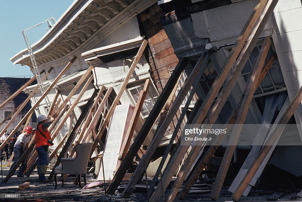 Emergency workers prop up a collapsed building in the Marina district disaster zone after the earthquake measuring 71 on the richter scale rocks game...