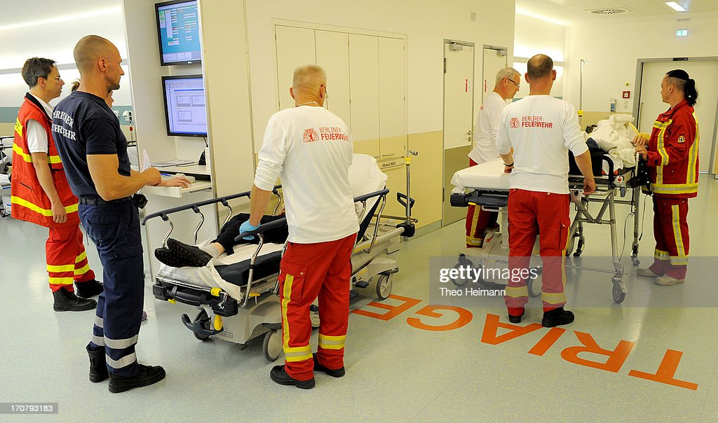 Emergency workers stand among patients delivered at the Unfallkrankenhaus Berlin (UKB) hospital in Marzahn district on June 17, 2013 in Berlin, Germany. The UKB hospital has among the most modern emergency care services in Germany.