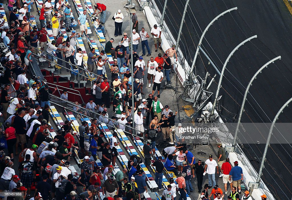 Emergency workers tend to fans injured in an incident at the finish of the NASCAR Nationwide Series DRIVE4COPD 300 at Daytona International Speedway on February 23, 2013 in Daytona Beach, Florida.
