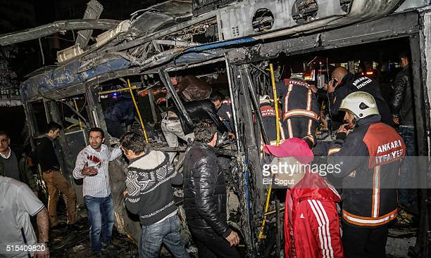 Emergency workers work in a bus at the explosion site on March 13 2016 in Ankara Turkey At least 27 people were killed and 75 wounded in an explosion...