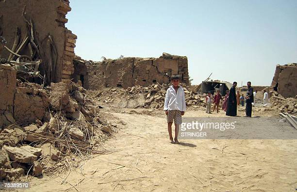 TO GO WITH AFP STORY BY JOE KRAUSS An Iraqi boy stands amidst destruction at the village of Emerli near the oil rich city of Kirkuk north of Baghdad...