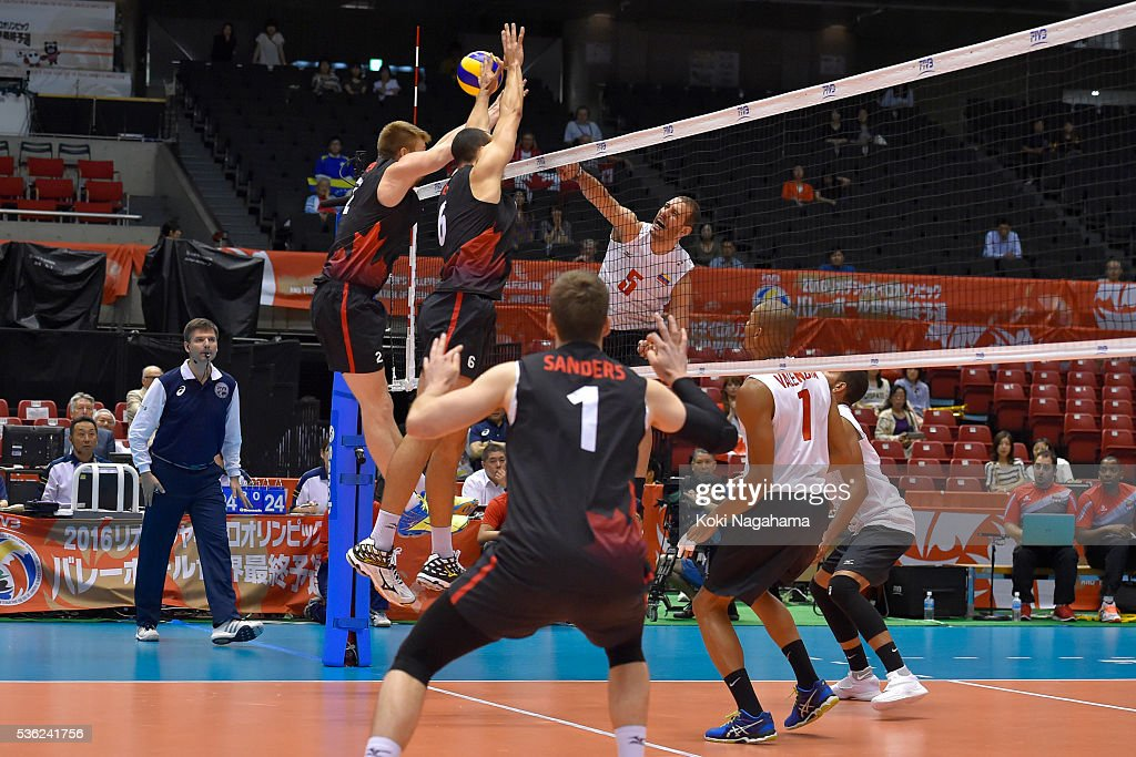Emerson Alexander Rodriguez Gonzalez #5 of Venezuela spikes the ball during the Men's World Olympic Qualification game between Venezuela and Canada at Tokyo Metropolitan Gymnasium on June 1, 2016 in Tokyo, Japan.
