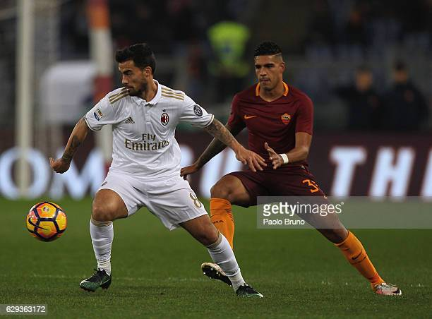 Emerson AS Roma competes for the ball with Suso of AC Milan during the Serie A match between AS Roma and AC Milan at Stadio Olimpico on December 12...