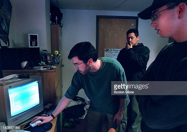Emerson College students left to right Devon Halley Danny Ham and Matthew Hynes listen to music in mp3 format on the internet