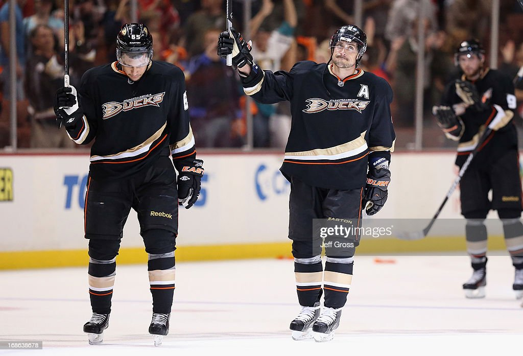 Emerson Etem (L) #65 and Teemu Selanne #8 of the Anaheim Ducks hang their heads following their teams 3-2 loss to the Detroit Red Wings in Game Seven of the Western Conference Quarterfinals during the 2013 NHL Stanley Cup Playoffs at Honda Center on May 12, 2013 in Anaheim, California.