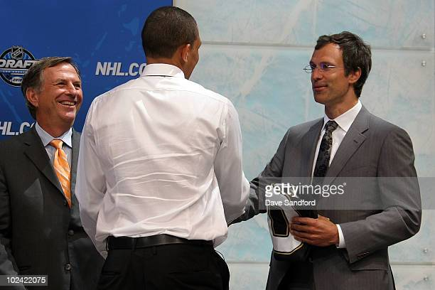 Emerson Etem drafted 29th overall by the Anaheim Ducks shakes hands with Scott Niedermayer during the 2010 NHL Entry Draft at Staples Center on June...