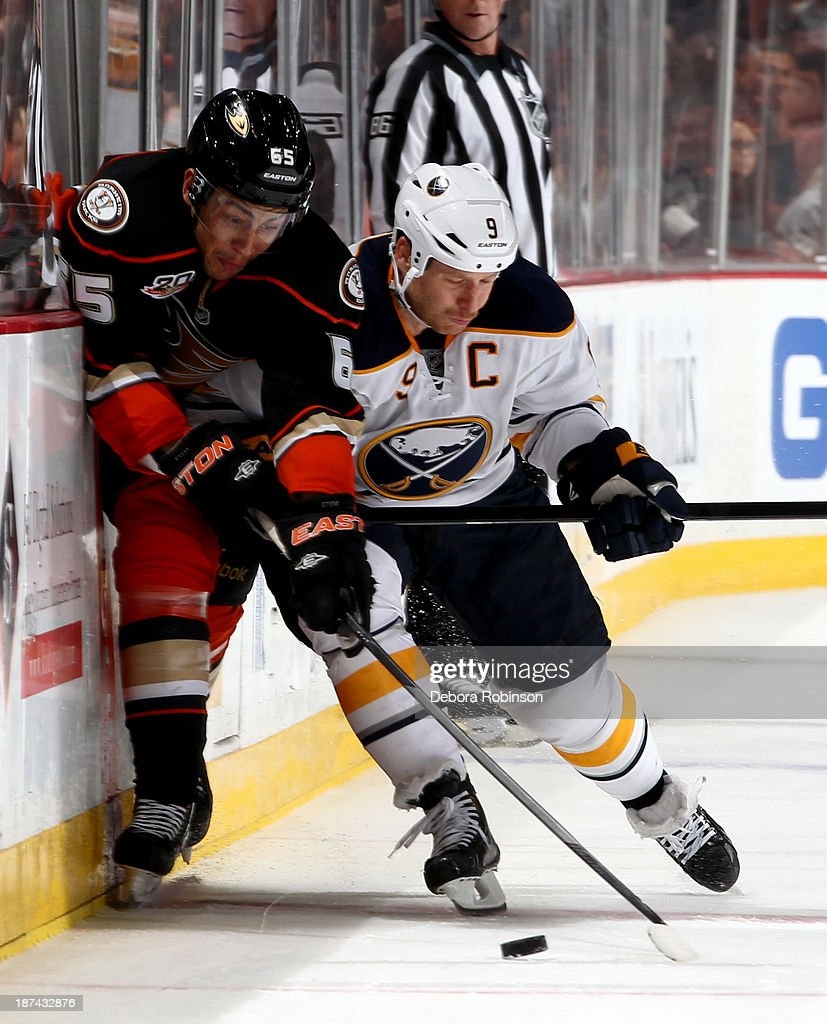 <a gi-track='captionPersonalityLinkClicked' href=/galleries/search?phrase=Emerson+Etem&family=editorial&specificpeople=6365314 ng-click='$event.stopPropagation()'>Emerson Etem</a> #65 of the Anaheim Ducks and <a gi-track='captionPersonalityLinkClicked' href=/galleries/search?phrase=Steve+Ott&family=editorial&specificpeople=210616 ng-click='$event.stopPropagation()'>Steve Ott</a> #9 of the Buffalo Sabres fight for procession of the puck at Honda Center on November 8, 2013 in Anaheim, California.