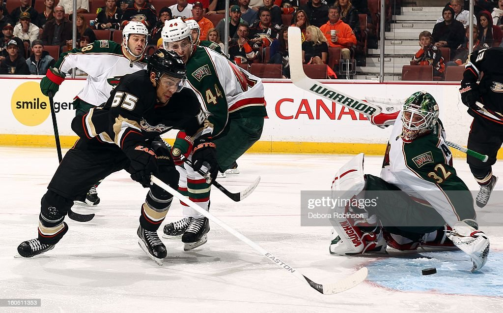 <a gi-track='captionPersonalityLinkClicked' href=/galleries/search?phrase=Emerson+Etem&family=editorial&specificpeople=6365314 ng-click='$event.stopPropagation()'>Emerson Etem</a> #65 of the Anaheim Ducks battles for the puck against <a gi-track='captionPersonalityLinkClicked' href=/galleries/search?phrase=Justin+Falk&family=editorial&specificpeople=4324950 ng-click='$event.stopPropagation()'>Justin Falk</a> #44 and goalie Niklas Backstrom #32 of the Minnesota Wild on February 1, 2013 at Honda Center in Anaheim, California.