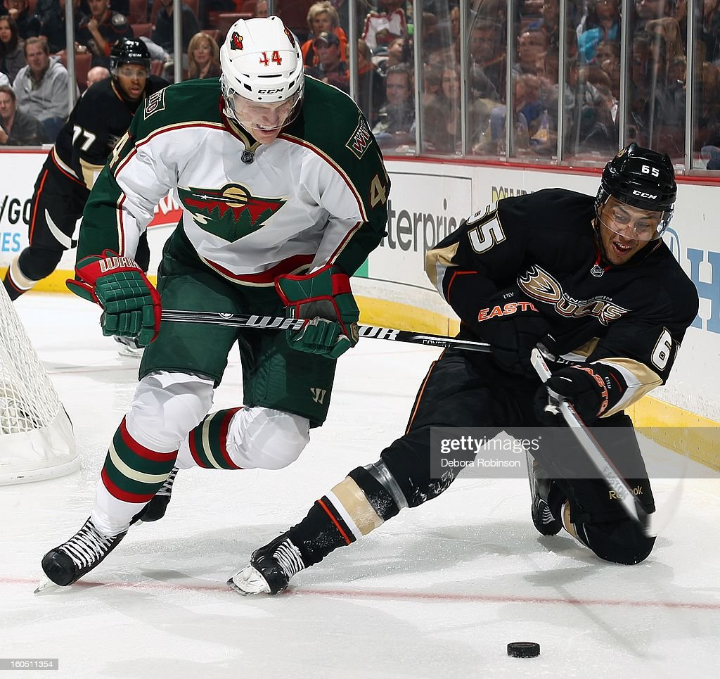 <a gi-track='captionPersonalityLinkClicked' href=/galleries/search?phrase=Emerson+Etem&family=editorial&specificpeople=6365314 ng-click='$event.stopPropagation()'>Emerson Etem</a> #65 of the Anaheim Ducks battles for the puck against <a gi-track='captionPersonalityLinkClicked' href=/galleries/search?phrase=Justin+Falk&family=editorial&specificpeople=4324950 ng-click='$event.stopPropagation()'>Justin Falk</a> #44 of the Minnesota Wild on February 1, 2013 at Honda Center in Anaheim, California.