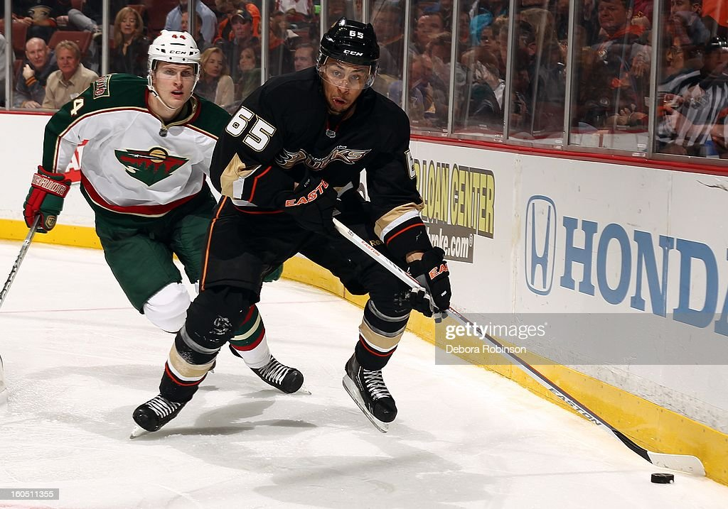 <a gi-track='captionPersonalityLinkClicked' href=/galleries/search?phrase=Emerson+Etem&family=editorial&specificpeople=6365314 ng-click='$event.stopPropagation()'>Emerson Etem</a> #65 of the Anaheim Ducks clears the puck away from <a gi-track='captionPersonalityLinkClicked' href=/galleries/search?phrase=Justin+Falk&family=editorial&specificpeople=4324950 ng-click='$event.stopPropagation()'>Justin Falk</a> #44 of the Minnesota Wild on February 1, 2013 at Honda Center in Anaheim, California.