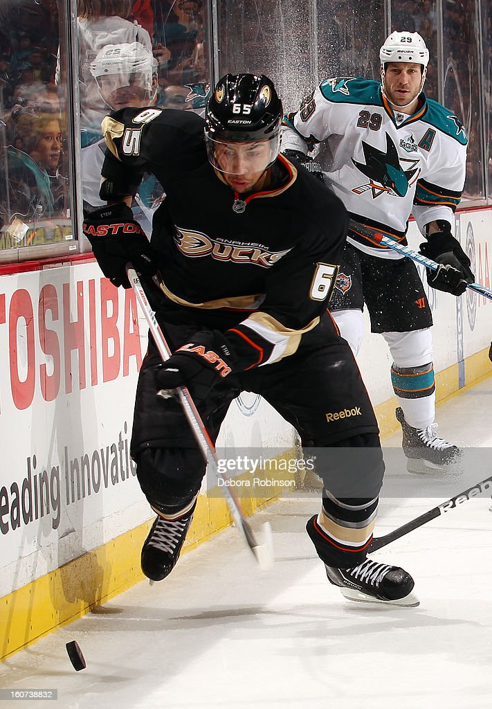 Emerson Etem #65 of the Anaheim Ducks handles the puck against Ryane Clowe #29 of the San Jose Sharks on February 4, 2013 at Honda Center in Anaheim, California.