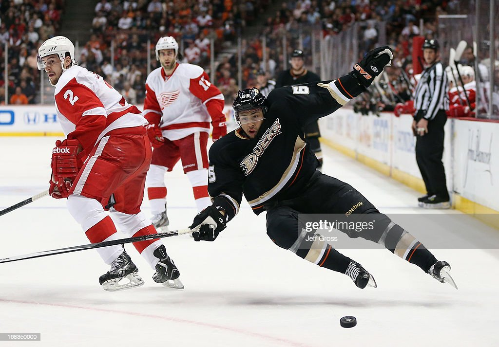 <a gi-track='captionPersonalityLinkClicked' href=/galleries/search?phrase=Emerson+Etem&family=editorial&specificpeople=6365314 ng-click='$event.stopPropagation()'>Emerson Etem</a> #65 of the Anaheim Ducks is checked by Brendan Smith #2 of the Detroit Red Wings in the first period in Game Five of the Western Conference Quarterfinals during the 2013 NHL Stanley Cup Playoffs at Honda Center on May 8, 2013 in Anaheim, California. The Ducks defeated the Red Wings 3-2 in overtime.