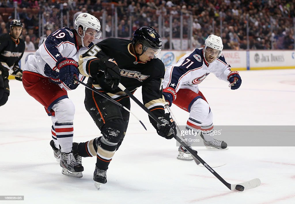 <a gi-track='captionPersonalityLinkClicked' href=/galleries/search?phrase=Emerson+Etem&family=editorial&specificpeople=6365314 ng-click='$event.stopPropagation()'>Emerson Etem</a> #65 of the Anaheim Ducks is pursued by <a gi-track='captionPersonalityLinkClicked' href=/galleries/search?phrase=Ryan+Johansen&family=editorial&specificpeople=6698841 ng-click='$event.stopPropagation()'>Ryan Johansen</a> (L) #19 and <a gi-track='captionPersonalityLinkClicked' href=/galleries/search?phrase=Nick+Foligno&family=editorial&specificpeople=537821 ng-click='$event.stopPropagation()'>Nick Foligno</a> #71 of the Columbus Blue Jackets for the puck in the second period at Honda Center on April 17, 2013 in Anaheim, California. The Blue Jackets defeated the Ducks 3-2 in overtime.