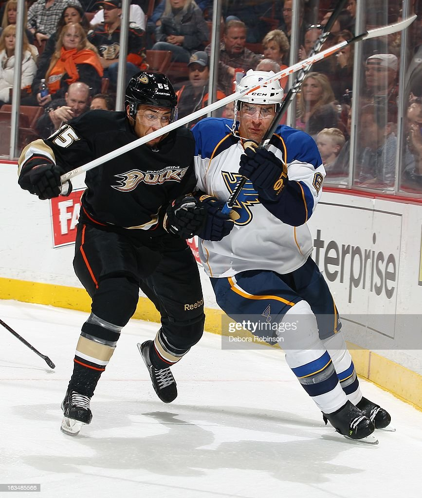 Emerson Etem #65 of the Anaheim Ducks mixes it up with Wade Redden #6 of the St. Louis Blues on March 10, 2013 at Honda Center in Anaheim, California.