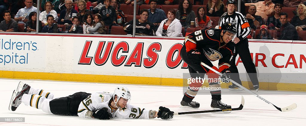 <a gi-track='captionPersonalityLinkClicked' href=/galleries/search?phrase=Emerson+Etem&family=editorial&specificpeople=6365314 ng-click='$event.stopPropagation()'>Emerson Etem</a> #65 of the Anaheim Ducks shoots the puck against <a gi-track='captionPersonalityLinkClicked' href=/galleries/search?phrase=Philip+Larsen&family=editorial&specificpeople=5370941 ng-click='$event.stopPropagation()'>Philip Larsen</a> #36 of the Dallas Stars on April 5, 2013 at Honda Center in Anaheim, California.