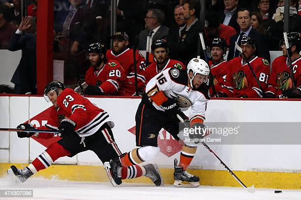 Emerson Etem of the Anaheim Ducks skates with the puck in the first period as Kris Versteeg of the Chicago Blackhawks defends in Game Three of the...