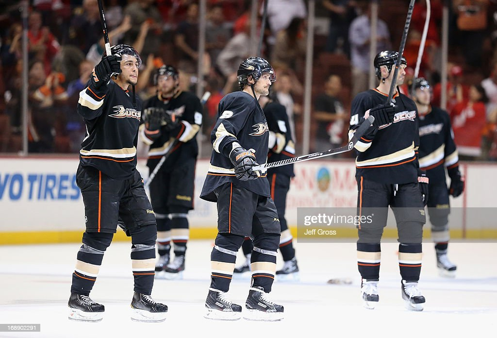 Emerson Etem Teemu Selanne and Sheldon Souray of the Anaheim Ducks acknowledge the fans following the Ducks 32 loss to the Detroit Red Wings in Game...