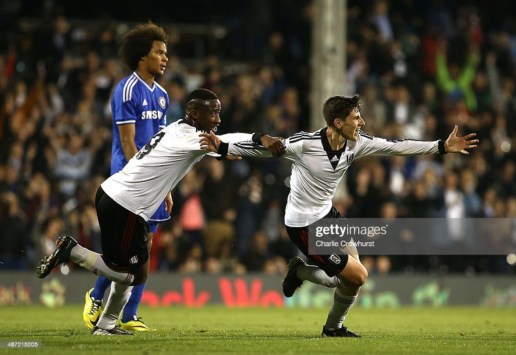 Emerson Hyndman of Fulham celebrates with Moussa Dembele after scoring the teams second goal during the FA Youth Cup Final: First Leg match between Fulham and Chelsea at Craven Cottage on April 28, 2014 in London, England.