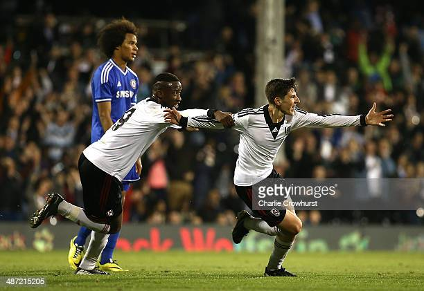 Emerson Hyndman of Fulham celebrates with Moussa Dembele after scoring the teams second goal during the FA Youth Cup Final First Leg match between...