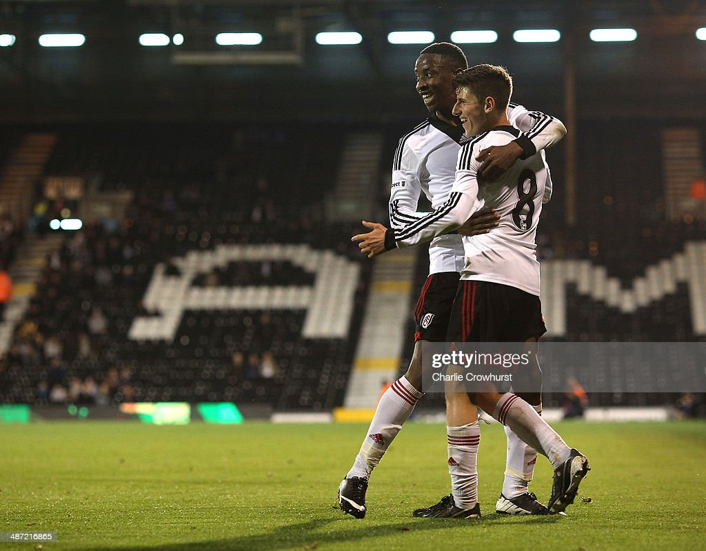 Emerson Hyndman of Fulham celebrates with team mate and fellow goal scorer Moussa Dembele after scoring the teams second goal during the FA Youth Cup Final: First Leg match between Fulham and Chelsea at Craven Cottage on April 28, 2014 in London, England.