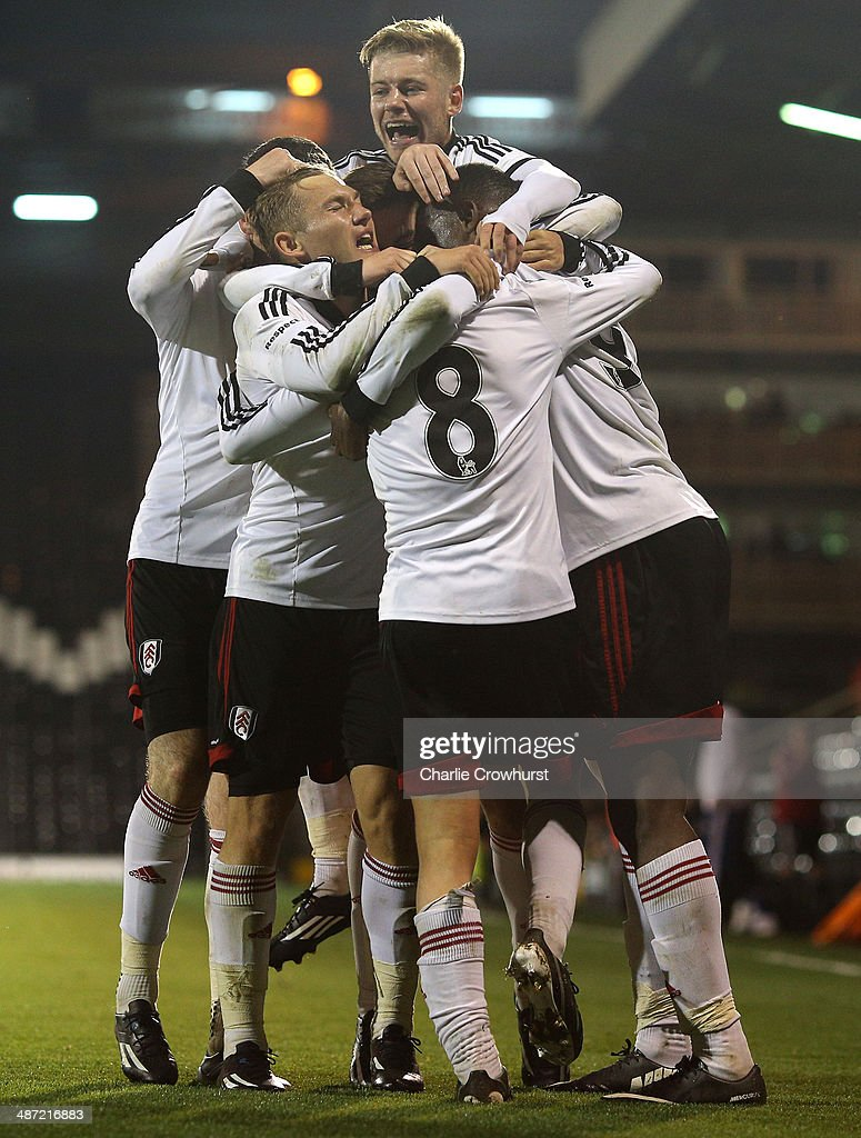 Emerson Hyndman of Fulham (8) celebrates with team mates after scoring the teams second goal of the game during the FA Youth Cup Final: First Leg match between Fulham and Chelsea at Craven Cottage on April 28, 2014 in London, England.