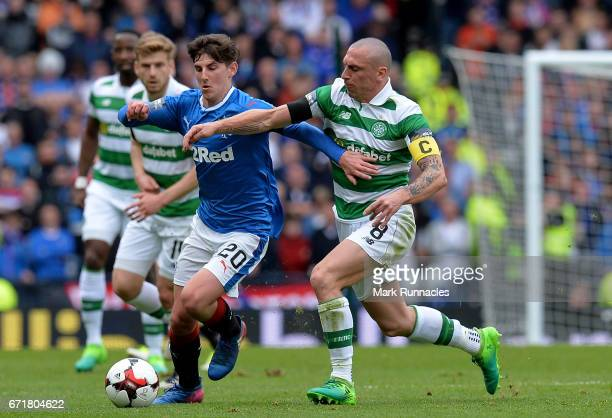 Emerson Hyndman of Rangers and Scott Brown of Celtic compete for the ball during the Scottish Cup SemiFinal match between Celtic and Rangers at...