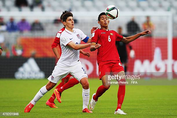Emerson Hyndman of USA competes with Kyaw Min Oo of Myanmar for the ball during the FIFA U20 World Cup Group A match between USA and Myanmar at the...