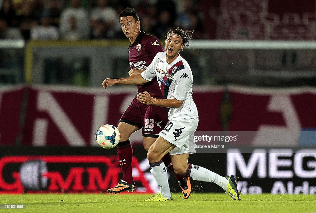 Emerson of As Livorno Calcio battles for the ball with <a gi-track='captionPersonalityLinkClicked' href=/galleries/search?phrase=Albin+Ekdal&family=editorial&specificpeople=5476567 ng-click='$event.stopPropagation()'>Albin Ekdal</a> (R) of Cagliari Calcio during the Serie A match between AS Livorno and Cagliari Calcio at Stadio Armando Picchi on September 25, 2013 in Livorno, Italy.