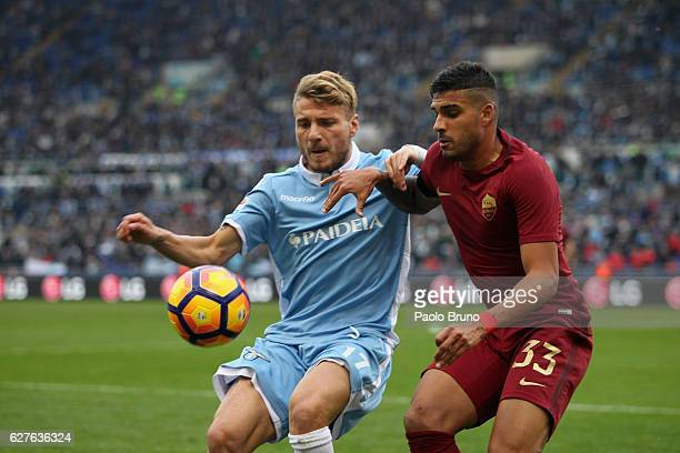 Emerson of AS Roma competes for the ball with Ciro Immobile of SS Lazio during the Serie A match between SS Lazio and AS Roma at Stadio Olimpico on...