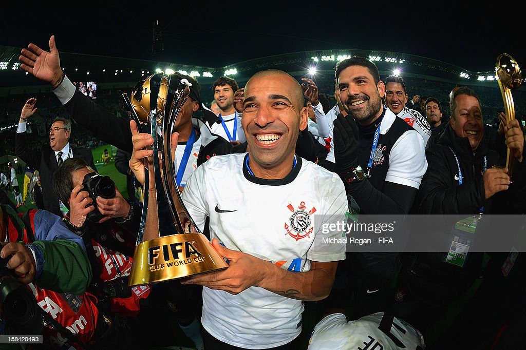 Emerson of Corinthians celebrates with the trophy after winning the FIFA Club World Cup Final Match between Corinthians and Chelsea at the International Stadium Yokohama on December 16, 2012 in Yokohama, Japan.