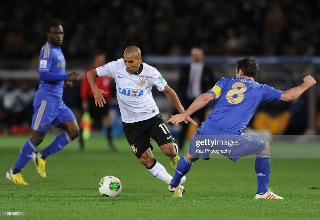 Emerson of Corinthians passes through Frank Lampard of Chelsea during the FIFA Club World Cup Final Match between Corinthians and Chelsea at International Stadium Yokohama on December 16, 2012 in Yokohama, Japan.