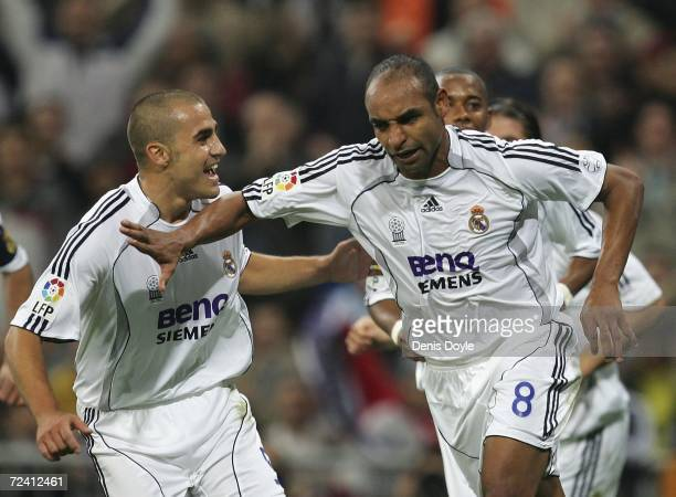 Emerson of Real Madrid pushes away Fabio Canavarro after scoring Real's first goal during the Primera Liga match between Real Madrid and Celta Vigo...