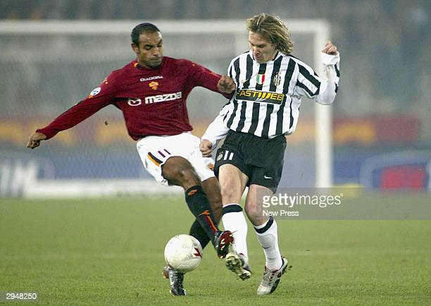 Emerson of Roma and Pavel Nedved of Juventus in action during the Serie A match Between Roma and Juventus at the Stadio Olimpico on February 8 2004...