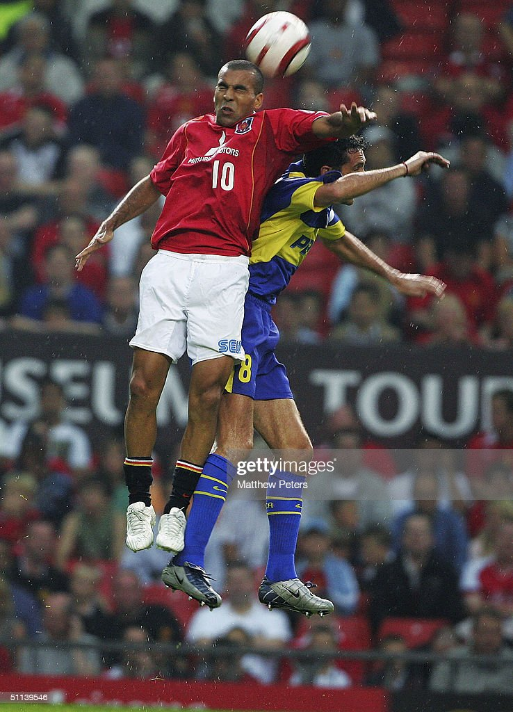 Emerson of Urawa Red Diamonds clashes with Diego Cagna of Boca Juniors during the Vodafone Cup preseason match between Urawa Red Diamonds and Boca...